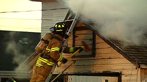 Fire crews tackle a garage blaze in north-central Edmonton on Thursday morning. (May 10)