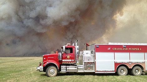 Crews worked Sunday to contain a wildfire burning north west of Grassland, Alta. Photo by: Curtis Chamzuk. May 13.