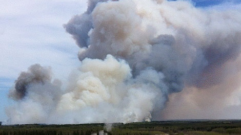 Crews are working to contain a wildfire burning north west of Grassland, Alta. May 13.