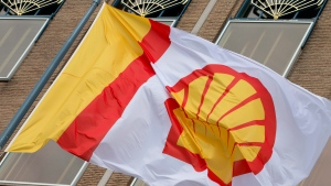 A flag bears the logo of Royal Dutch Shell outside the head office in The Hague, Netherlands, on Monday, April 7, 2014. (AP / Peter Dejong)