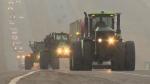 The convoy stretched down the highway as farmers and ranchers made their way to Olds to discuss Bill 6.