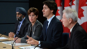 Prime Minister Justin Trudeau answers a question as he is joined by Minister of National Defence Harjit Sajjan, left to right, Minister of International Development and La Francophonie Marie-Claude Bibeau and Minister of Foreign Affairs Stephane Dion during a press conference at the National Press Theatre in Ottawa on Monday, Feb. 8, 2016. (Sean Kilpatrick / THE CANADIAN PRESS)
