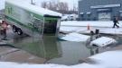 Truck stuck in giant sinkhole in Kitche