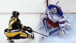 New York Rangers goalie Henrik Lundqvist stops a shot by Pittsburgh Penguins' Carl Hagelin during the third period of an NHL hockey game in Pittsburgh, Wednesday, Feb. 10, 2016. (AP / Gene J. Puskar)