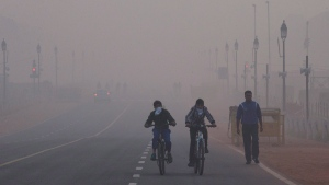 Cyclists ride in New Delhi, India, Tuesday, Jan. 5, 2016. (AP Photo/Manish Swarup)