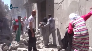This image made from video released by Qasion News Agency, a media opposition platform that relies on a network of activists on the ground, on Friday, April 29, 2016 shows people scrambling through rubble following airstrikes in Aleppo, Syria. Insurgents shelled a mosque in a government-held neighborhood of Aleppo, killing at least 15 people as they left Friday prayers, while government airstrikes struck rebel-held parts of Syria's largest city — even as the army unilaterally declared a brief truce in other parts of the country. (Qasion News Agency via AP)