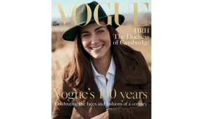 In this handout photo provided by British Vogue on Sunday, May 1, 2016, Kate, the Duchess of Cambridge poses in Norfolk, England, for the magazine's centenary issue. (Josh Olins/British Vogue via AP)