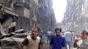In this image made from video and posted online from Validated UGC, men look at damaged buildings after airstrikes hit Aleppo, Syria, Thursday, April 28, 2016. (Validated UGC via AP video)
