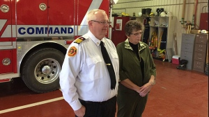 Mayerthorpe Fire Chief Randy Schroeder and Mayor Kate Patrick speak to reporters on Sunday, May 1, 2016.