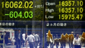 People are reflected on the electronic board of a securities firm in Tokyo, Monday, May 2, 2016. (AP / Shizuo Kambayashi)
