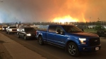 Residents of three Fort McMurray neighbourhoods try to evacuate after mandatory evacuation notices were issued after 2 p.m. Tuesday, May 3, 2016.