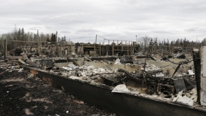 Destroyed townhouses in the Abasand neighborhood of Fort McMurray, Alberta, are viewed after a massive wildfire, Monday, May 9, 2016. A break in the weather has officials optimistic they have reached a turning point on getting a handle on the massive wildfire. (AP Photo/Rachel La Corte)