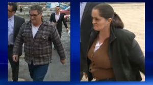 Police escort Emil and Rodica Radita to the CPS arrest processing unit in February 2014