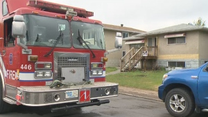 Fire crews respond to the scene of a house fire at 10437 79 Street in Edmonton on Monday, May 23, 2016.