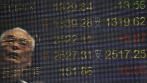 A man is reflected on the electronic board of a securities firm in Tokyo on Monday, May 23. 2016. (AP / Koji Sasahara)