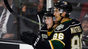 London Knights' Max Jones, left, celebrates his goal with teammate Chris Martenet during second period CHL Memorial Cup hockey action against the Rouyn-Noranda Huskies in Red Deer, on May 24, 2016. (Jeff McIntosh / THE CANADIAN PRESS)