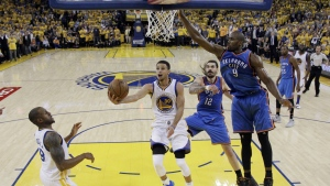 Golden State Warriors' Stephen Curry drives past Oklahoma City Thunder's Serge Ibaka and Steven Adams during the second half in Game 5 of the NBA basketball Western Conference finals Thursday in Oakland, Calif. on May 26, 2016. Golden State won 120-111. (AP / Marcio Jose Sanchez)