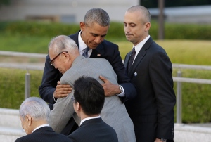U.S. President Barack Obama hugs Shigeaki Mori, an atomic bomb survivor and a creator of the memorial for American WWII POWs killed in Hiroshima, during a ceremony at Hiroshima Peace Memorial Park in Hiroshima, western, Japan, Friday, May 27, 2016. (AP Photo/Carolyn Kaster)
