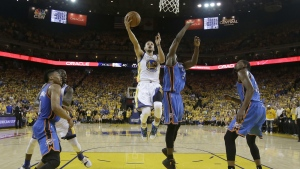 Golden State Warriors guard Stephen Curry shoots against Oklahoma City Thunder forward Serge Ibaka during the first half of Game 7 of the NBA basketball Western Conference finals in Oakland, Calif. on Monday, May 30, 2016. (AP / Marcio Jose Sanchez)