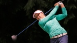 Brooke Henderson tees off on the fourth hole in the final round at the Women's PGA Championship golf tournament at Sahalee Country Club on Sunday, June 12, 2016, in Sammamish, Wash. (AP /Elaine Thompson)