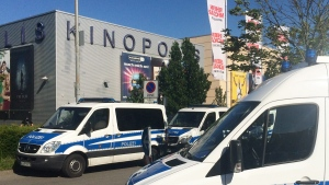 Police cars in front of a cinema in Viernheim near Mannheim, southern Germany, on June 23, 2016. (Simon Ribnitzky / dpa via AP)