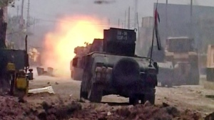 This image made from Associated Press video shows a tank fires during clashes in Fallujah, Iraq, Sunday, June 26, 2016. (AP Video via AP)