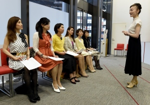 """This photo taken on April 7, 2016 shows the Japan High Heel Association managing director """"Madame"""" Yumiko giving a lesson on high heels in Tokyo.  (© AFP PHOTO/TOSHIFUMI KITAMURA)"""