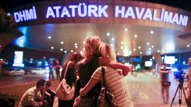 Passengers embrace each other at the entrance to Istanbul's Ataturk airport, early Wednesday, June 29, 2016 following their evacuation after a blast. Suspected Islamic State group extremists have hit the international terminal of Istanbul's Ataturk airport, killing dozens of people and wounding many others. (AP Photo / Emrah Gurel)