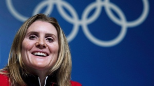 Hayley Wickenheiser smiles during a press conference before the 2014 Sochi Winter Olympics in Sochi, Russia on Wednesday, February 5, 2014. (THE CANADIAN PRESS/Nathan Denette)