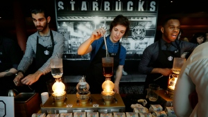 In this Wednesday, March 23, 2016, file photo, Starbucks workers prepare coffee using siphon vacuum coffee makers at a station in the lobby of the coffee company's annual shareholders meeting in Seattle. (AP / Ted S. Warren, File)