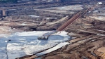 An oil sands facility seen from a helicopter near Fort McMurray, Alta., on July 10, 2012. (Jeff McIntosh / THE CANADIAN PRESS)
