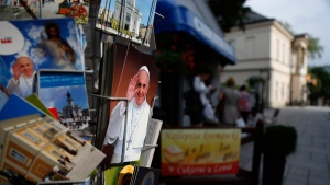 Postcards with photos of Pope Francis are displayed near museum of the John Paul in Wadowice, Poland, on July 26, 2016. (Amel Emric / AP)