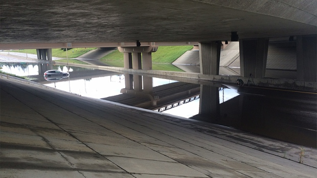 Water accumulated under 111 St. on the Whitemud overpass on Wednesday, July 27, following a heavy storm in the Edmonton area.