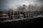 In this Tuesday, Oct. 2, 2012 file photo, smoke rises over Saif Al Dawla district, in Aleppo, Syria. (AP Photo/ Manu Brabo, File)