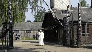 Pope Francis walks through the gate of the former Nazi German death camp of Auschwitz in Oswiecim, Poland on Friday, July 29, 2016. (AP / Gregorio Borgia)