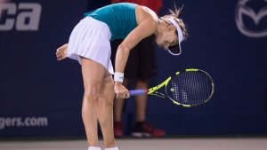 Eugenie Bouchard of Canada reacts during her match against Kristina Kucova of Slovakia during third round of play at the Rogers Cup tennis tournament Thursday July 28, 2016 in Montreal. (Paul Chiasson / THE CANADIAN PRESS)