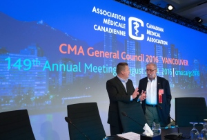 Dr. Granger Avery, right, incoming President of the Canadian Medical Association, speaks with Mike Colledge, President, Ipsos Reid Public Affairs Canada, during the opening day of the Canadian Medical Association's General Council 2016, in Vancouver, B.C., on Sunday August 21, 2016. (THE CANADIAN PRESS / Darryl Dyck)
