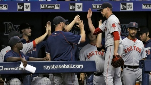 Boston Red Sox starting pitcher Clay Buchholz, second from right, celebrates with teammates after being taken out of the game against the Tampa Bay Rays during the seventh inning of a baseball game Tuesday, Aug. 23, 2016, in St. Petersburg, Fla. (AP / Chris O'Meara)