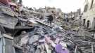 People walk on rubble following an earthquake in Amatrice Italy, Wednesday, Aug. 24, 2016. (Massimo Percossi/ANSA via AP)