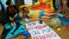 """Activists protest outside the French embassy, during the """"wear what you want beach party"""" in London, Thursday, Aug. 25, 2016. (AP / Frank Augstein)"""