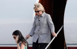Democratic presidential nominee Hillary Clinton and aide Huma Abedin, lower left, step from Clinton's campaign plane as they arrive at Van Nuys Airport in Van Nuys, Calif., Monday, Aug. 22, 2016. (AP / Carolyn Kaster)