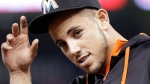 In this Monday, June 1, 2015, file photo, Miami Marlins pitcher Jose Fernandez replaces his cap after the singing of the national anthem before the start of a baseball game between the Miami Marlins and the Chicago Cubs, in Miami. The Marlins announced Sunday, Sept. 25, 2016, that ace right-hander Fernandez has died. The U.S. Coast Guard says Fernandez was one of three people killed in a boat crash off Miami Beach early Sunday. (AP Photo/Wilfredo Lee, File)