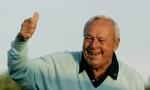 This April 5, 2007, file photo shows former Masters champion Arnold Palmer acknowledging the crowd after hitting the ceremonial first tee shot prior to the first round of the 2007 Masters golf tournament at the Augusta National Golf Club in Augusta, Ga. (AP / David J. Phillip)