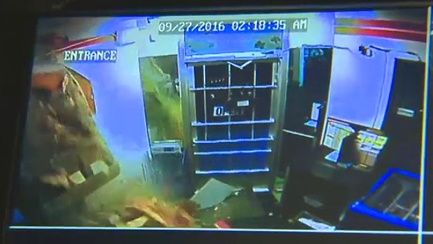 In a still taken from surveillance footage, a track hoe can be seen breaking through a wall at Sherbrooke Grocery early Tuesday, September 27.