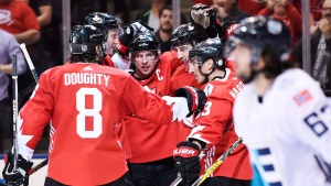Team Canada's Patrice Bergeron (37) celebrates his goal against Team Europe with teammates Brad Marchand (63), Sidney Crosby (87), Drew Doughty (8) and Jay Bouwmeester (4) as Europe's Mats Zuccarello (63) skates by during third period World Cup of Hockey finals action in Toronto on Tuesday, September 27, 2016. (THE CANADIAN PRESS / Nathan Denette)