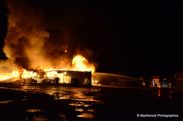 Firefighters battling the flames that destroyed the Bashaw Motor Inn Sunday. (MacKenzie Photographics).