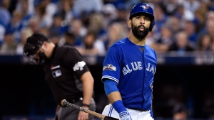 Toronto Blue Jays' Jose Bautista walks back to the dugout after striking out against the Cleveland Indians during third inning, game four American League Championship Series baseball action in Toronto on Tuesday, Oct. 18, 2016. (Nathan Denette/AP)