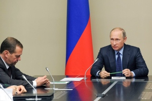Russian President Vladimir Putin, right, and Russian Prime Minister Dmitry Medvedev during a meeting with members of Russia Security Consul at the Novo-Ogaryovo residence outside Moscow outside Moscow, Russia, Friday, Oct. 21, 2016. (Mikhail Klimentyev, Sputnik, Kremlin)