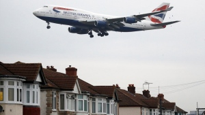 A plane approaches landing over the rooftops of nearby houses at Heathrow Airport in London, on Oct. 25, 2016. (Frank Augstein / AP)