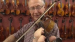 Alfie Myhre playing the fiddle